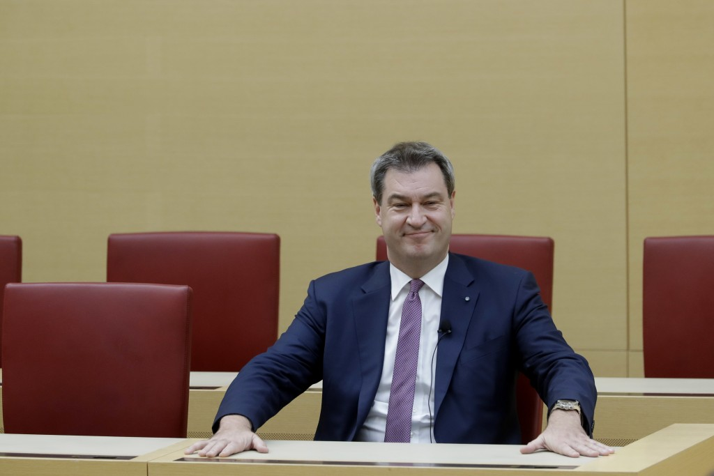 FILE - In this  Tuesday, Nov. 6, 2018 file photo Bavarian State Governor Markus Soeder takes his place after he was elected for his second term in the...