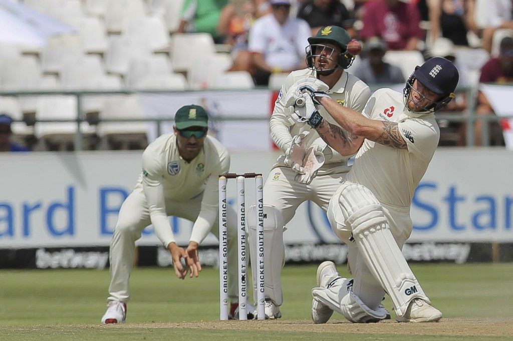 England's batsman Ben Stokes swings and misses, during day four of the second cricket test between South Africa and England at the Newlands Cricket St...