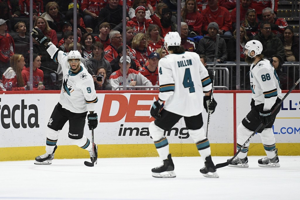 San Jose Sharks left wing Evander Kane (9) celebrates his goal with defensemen Brenden Dillon (4) and Brent Burns (88) during the second period of an ...