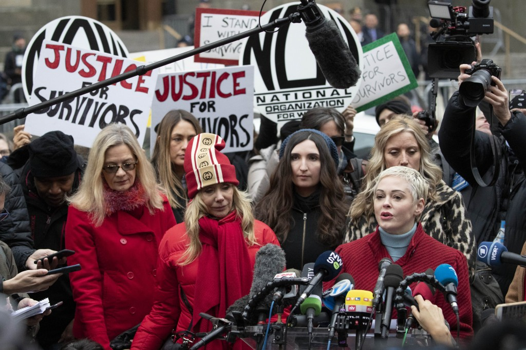 Actor Rose McGowan, right, speaks at a news conference as actor Rosanna Arquette, center left, listens outside a Manhattan courthouse after the arriva...
