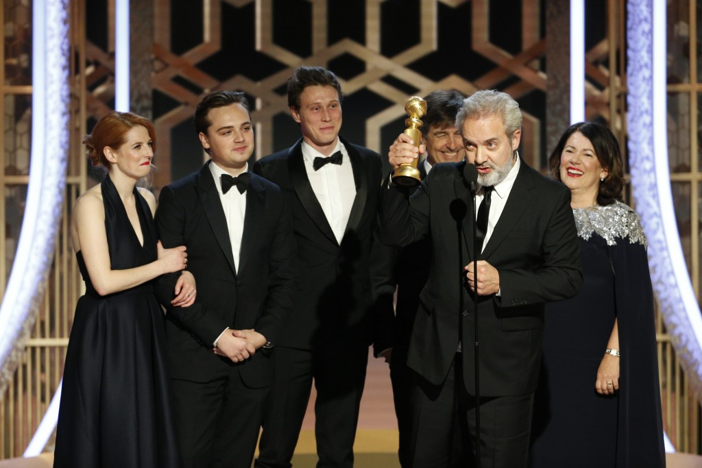 "This image released by NBC shows filmmaker Sam Mendes accepting the award for best motion picture drama for ""1917"" at the 77th Annual Golden Globe Awa..."