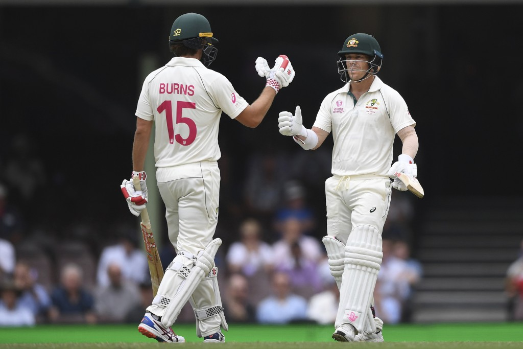 Australia's David Warner, right, celebrates his 50 with teammate Joe Burns on day four of the third cricket test match between Australia and New Zeala...
