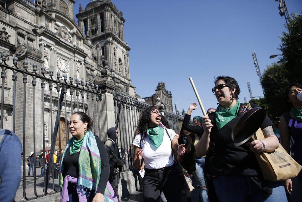 Women shout out after a performance in support of abortion rights in front the cathedral in Mexico City, Sunday, Jan. 5, 2020. Mexico's ruling party, ...