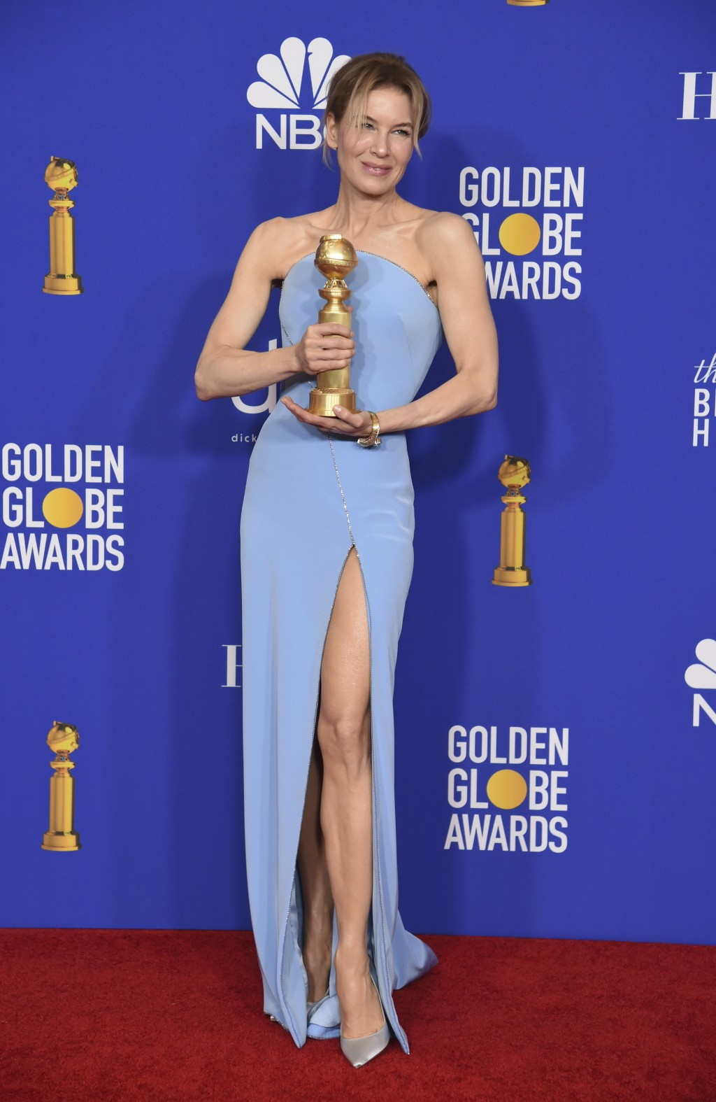 """Renee Zellweger poses in the press room with the award for best performance by an actress in a motion picture drama for """"Judy"""" at the 77th annual Gold..."""