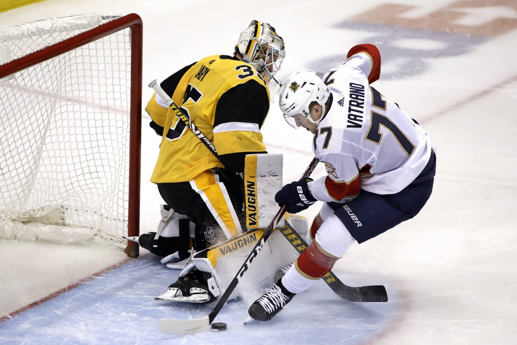 Florida Panthers' Frank Vatrano (77) puts a rebound behind Pittsburgh Penguins goaltender Tristan Jarry (35) for a goal during the first period of an ...