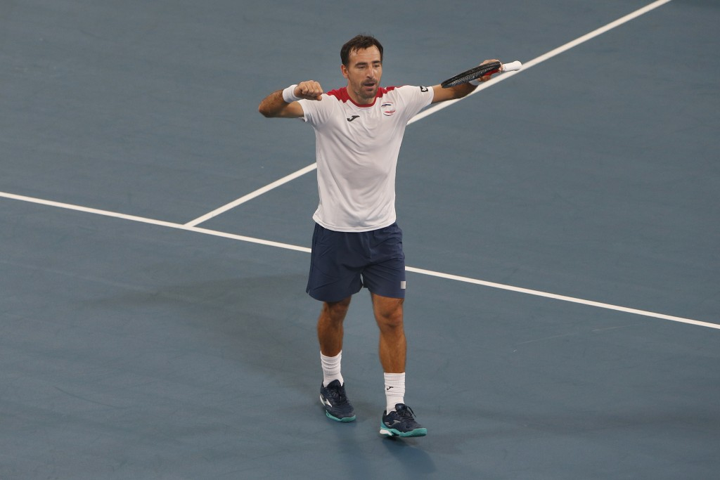 Ivan Dodig of Croatia reacts to winning the doubles match against Hubert Hurkacz and Lukasz Kubot of Poland during their ATP Cup tennis doubles match ...