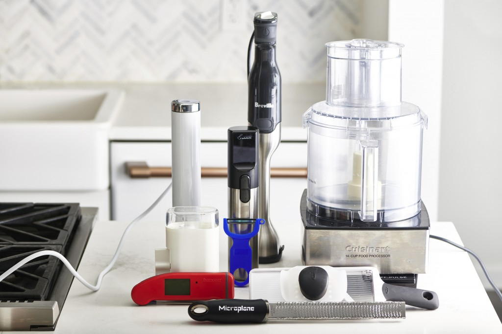 This December 2019 photo shows an assortment of various kitchen gadgets in New York, including a food processor, back right. (Cheyenne Cohen/Katie Wor...