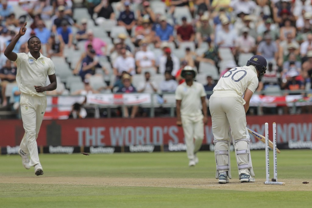 South Africa's Kagiso Rabada celebrates the wicket of England's batsman Ollie Pope during day four of the second cricket test between South Africa and...