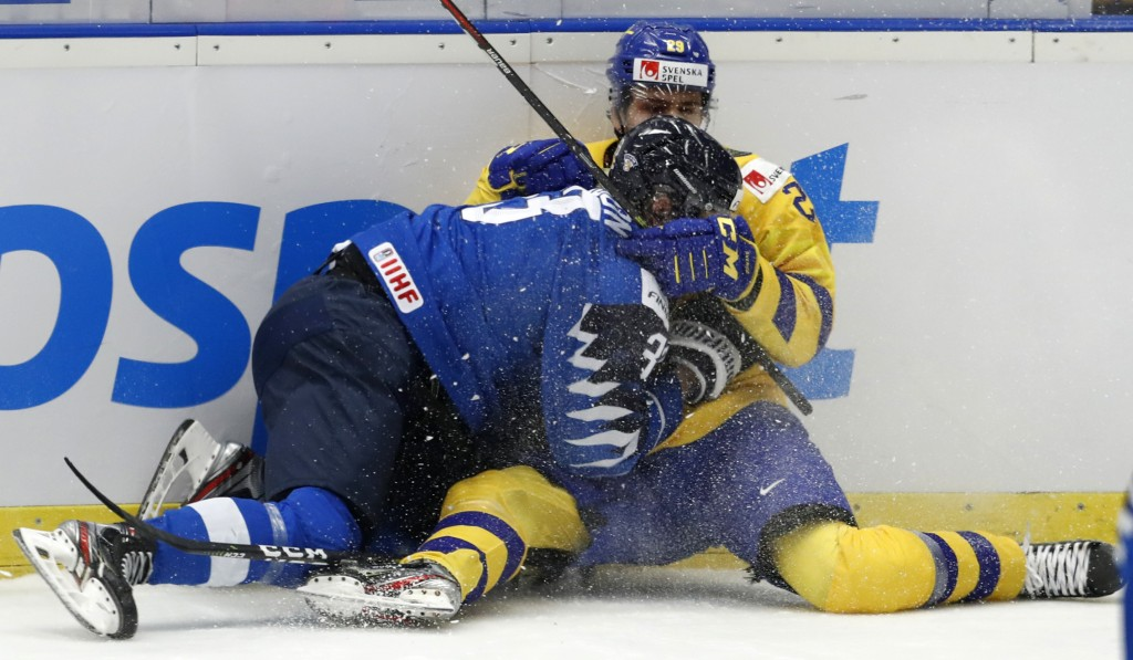 Finland's Lassi Thomson, left, collides with Sweden's Linus Nassen during the U20 Ice Hockey Worlds bronze medal match between Finland and Sweden in O...