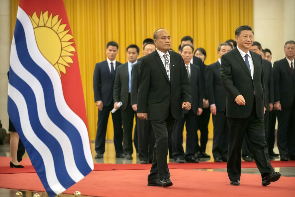Kiribati's President Taneti Maamau, left, and Chinese President Xi Jinping walk together during a welcome ceremony at the Great Hall of the People in ...