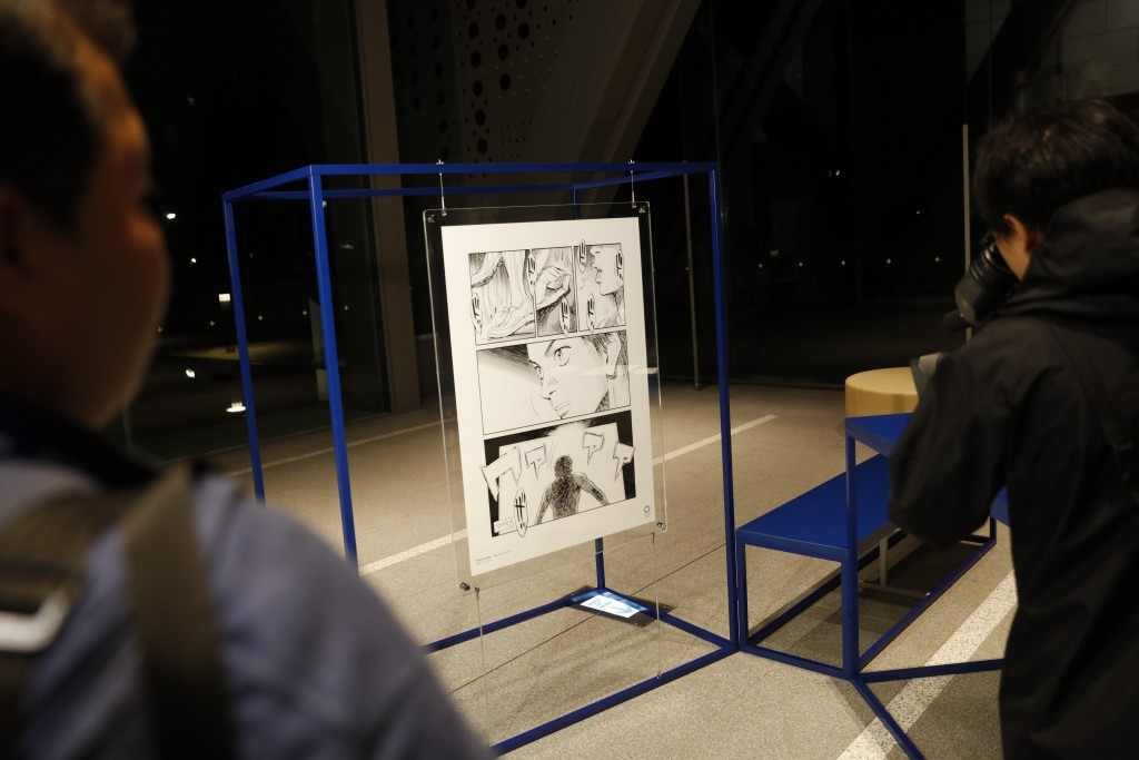 A poster created by artist Naoki Urasawa, one of 20 posters officially selected for the Tokyo Olympics and Paralympics, is on display at the Museum of...