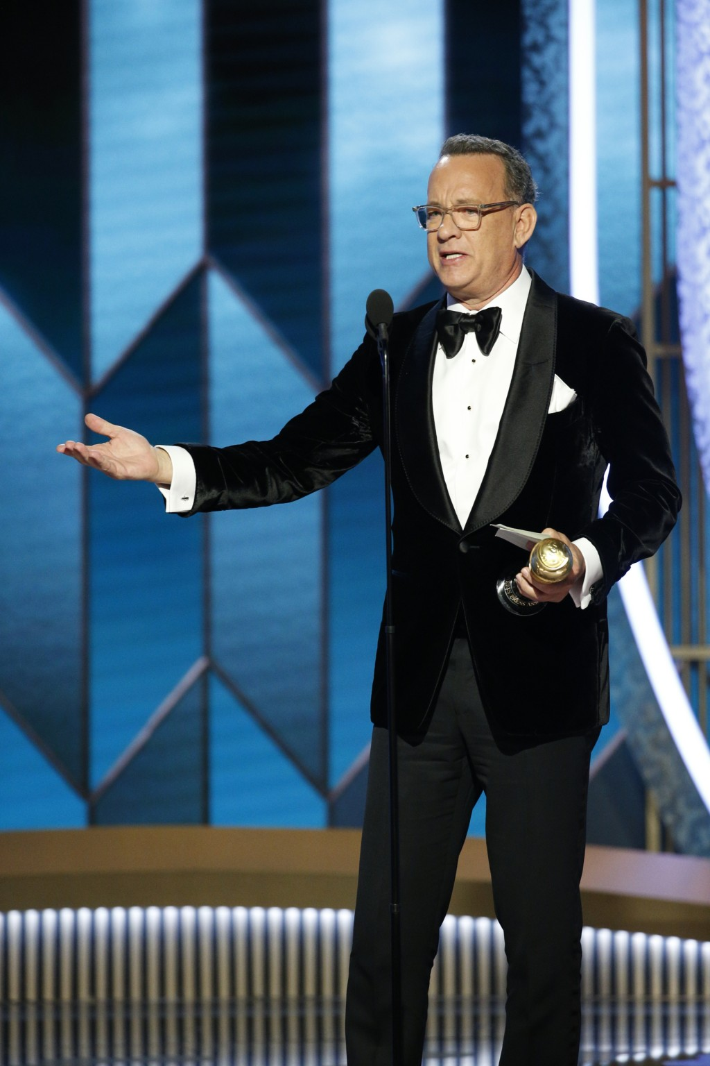 This image released by NBC shows Tom Hanks accepting the Cecil B. DeMille Award at the 77th Annual Golden Globe Awards at the Beverly Hilton Hotel in ...
