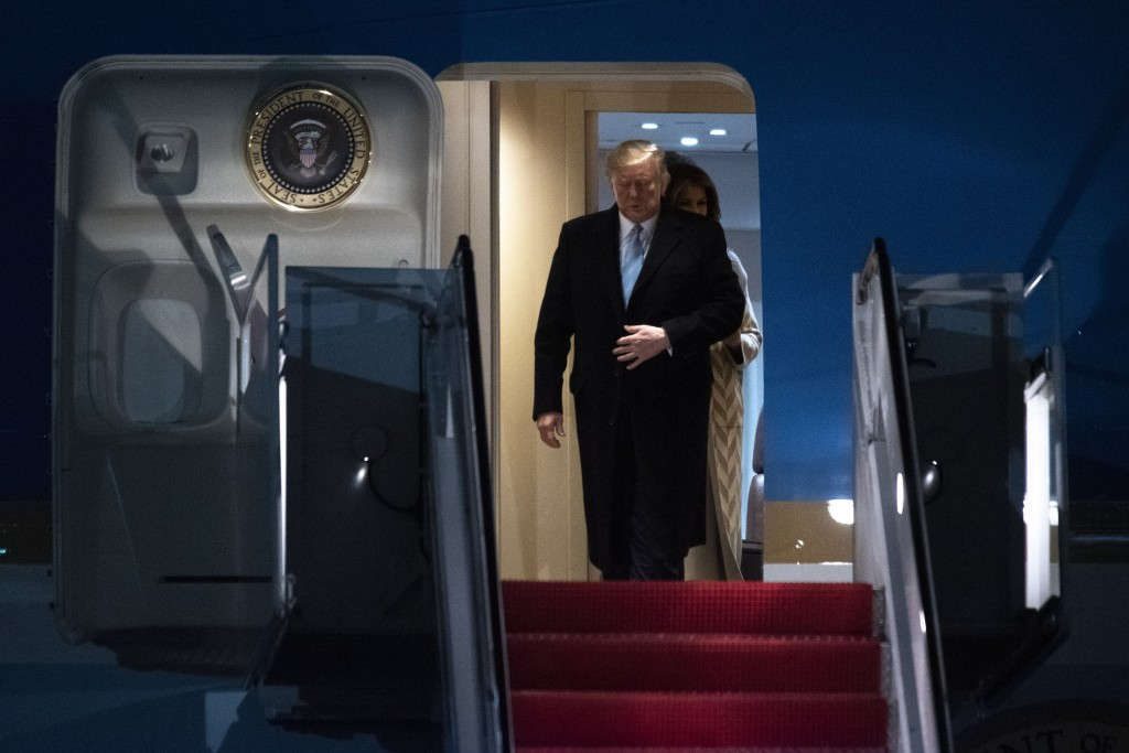 President Donald Trump and first lady Melania Trump exit Air Force One, Sunday, Jan. 5, 2020, at Andrews Air Force Base, Md., following a trip to his ...