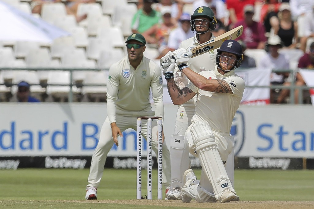 England's batsman Ben Stokes smashes the ball for six during day four of the second cricket test between South Africa and England at the Newlands Cric...