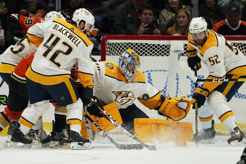 Nashville Predators goaltender Juuse Saros blocks a shot against the Anaheim Ducks during the first period of an NHL hockey game in Anaheim, Calif., S...