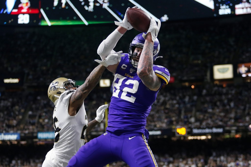 Minnesota Vikings tight end Kyle Rudolph (82) pulls in the game winning touchdown pass over New Orleans Saints cornerback P.J. Williams (26) during ov...