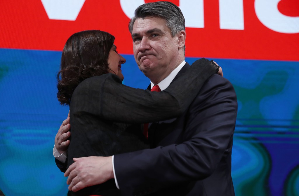 Zoran Milanovic, the liberal opposition candidate, right, hugs his spouse Sanja Music Milanovic after his headquarters claimed victory in a presidenti...