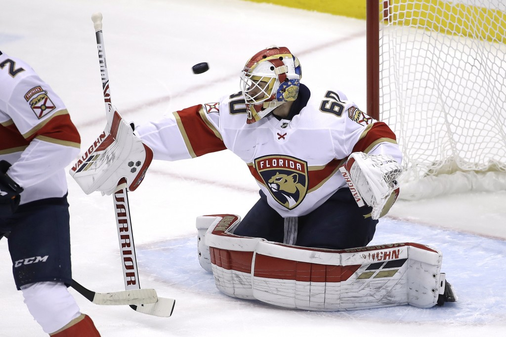A shot by Pittsburgh Penguins' Jared McCann gets past Florida Panthers goaltender Chris Driedger, right, for a goal during the first period of an NHL ...