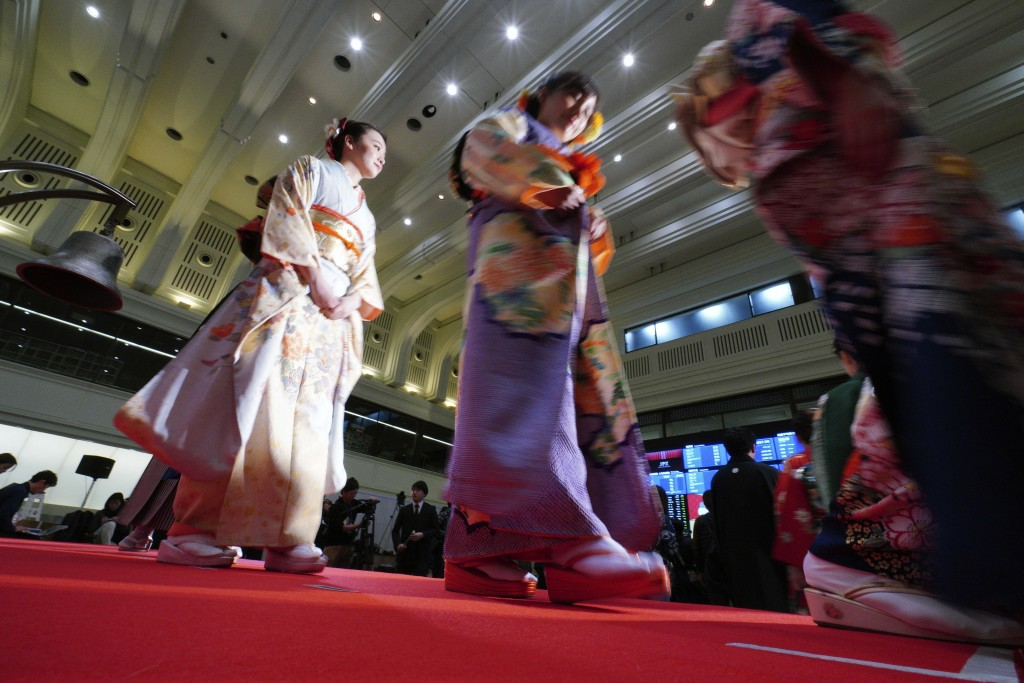 Kimono-clad employees of the Tokyo Stock Exchange and models walk out from the stage during a ceremony marking the start of this year's trading in Tok...