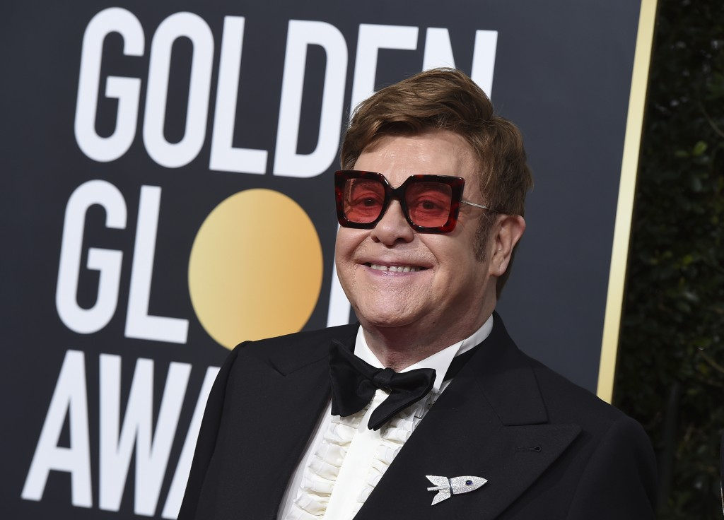 Elton John arrives at the 77th annual Golden Globe Awards at the Beverly Hilton Hotel on Sunday, Jan. 5, 2020, in Beverly Hills, Calif. (Photo by Jord...