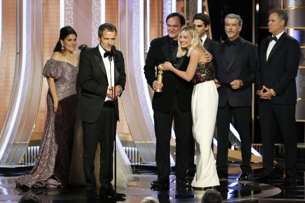 This image released by NBC shows Shannon McIntosh, from left, David Heyman, Quentin Tarantino and Margot Robbie accepting the award for best motion pi...