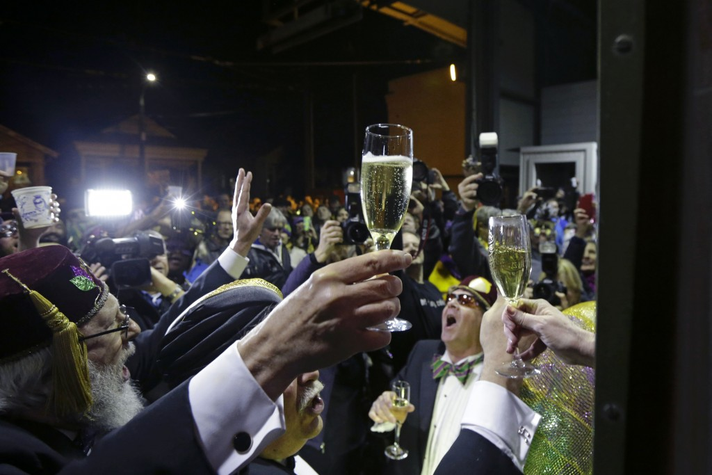 FILE - In this Jan. 6, 2015, file photo, members of the Phunny Phorty Phellows, participate in their night of revelry aboard a streetcar in New Orlean...