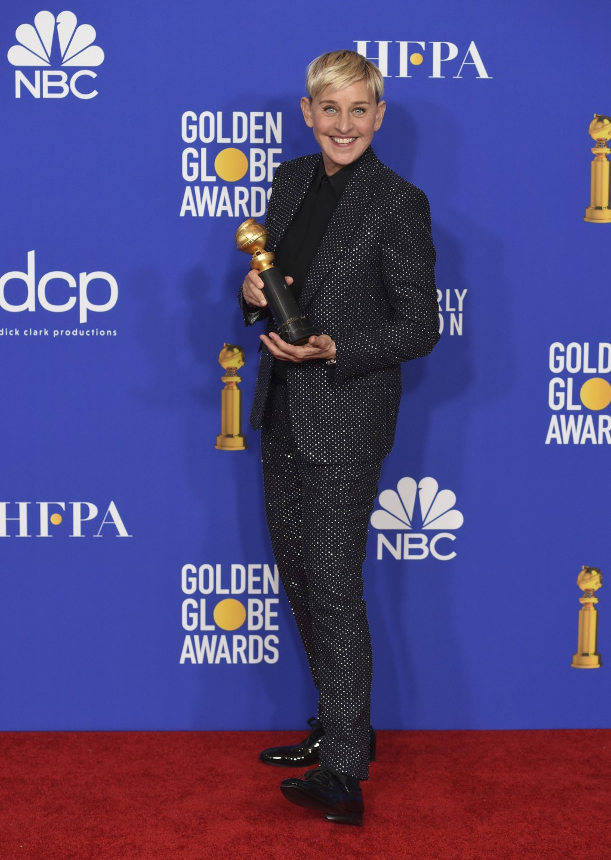 Ellen DeGeneres, winner of the Carol Burnett award, poses in the press room at the 77th annual Golden Globe Awards at the Beverly Hilton Hotel on Sund...