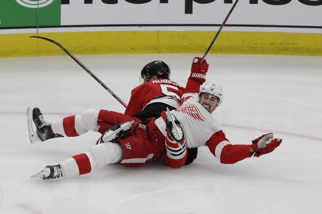 Detroit Red Wings center Dylan Larkin (71) reacts after he was checking by Chicago Blackhawks defenseman Connor Murphy (5) during the first period of ...