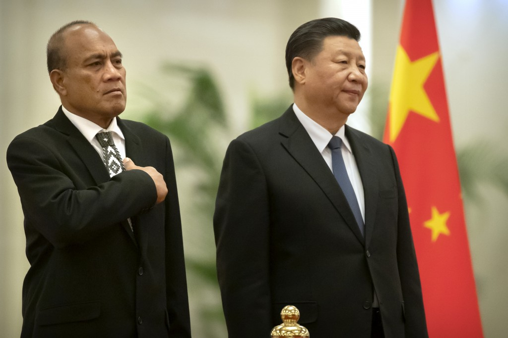 Kiribati's President Taneti Maamau, left, and Chinese President Xi Jinping stand together during a welcome ceremony at the Great Hall of the People in...