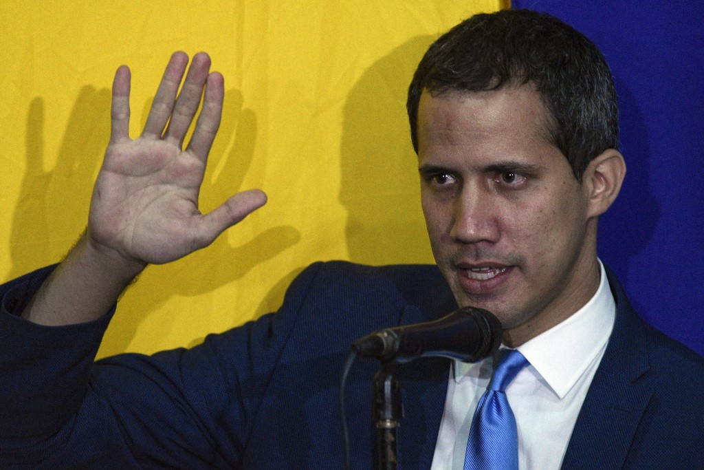 National Assembly President Juan Guaido swears himself in as President of the National Assembly with opposition lawmaker votes at the newspaper El Nac...