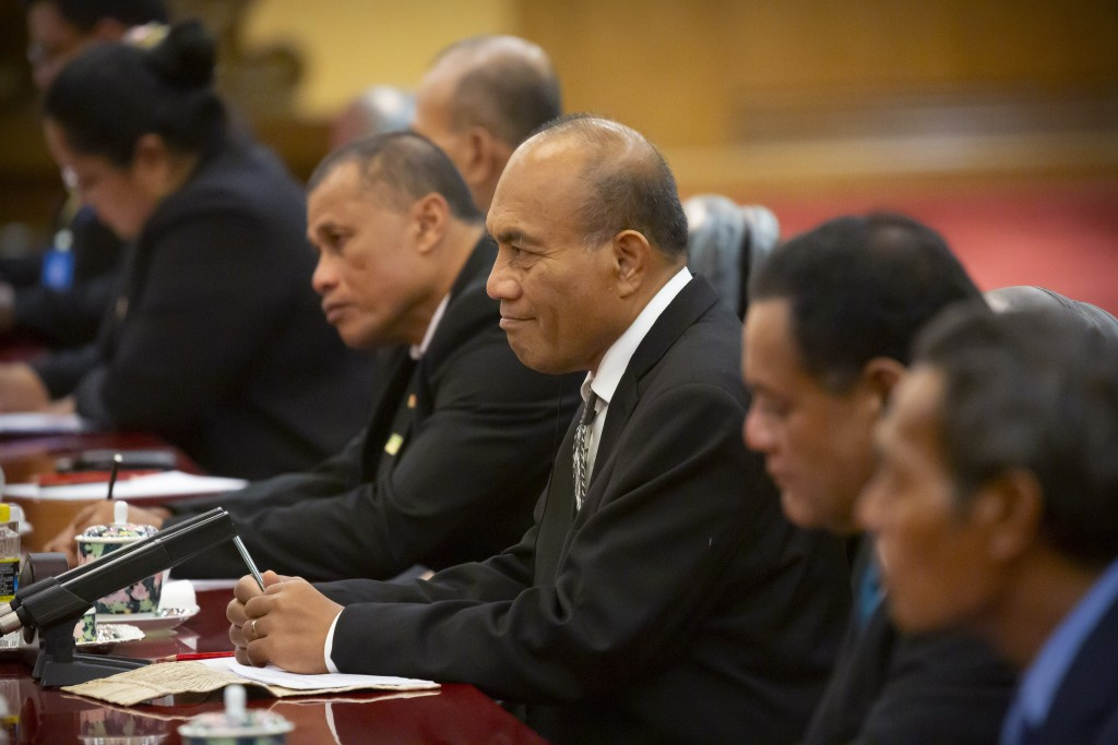 Kiribati's President Taneti Maamau, center, listens as Chinese President Xi Jinping speaks during a meeting at the Great Hall of the People in Beijing...