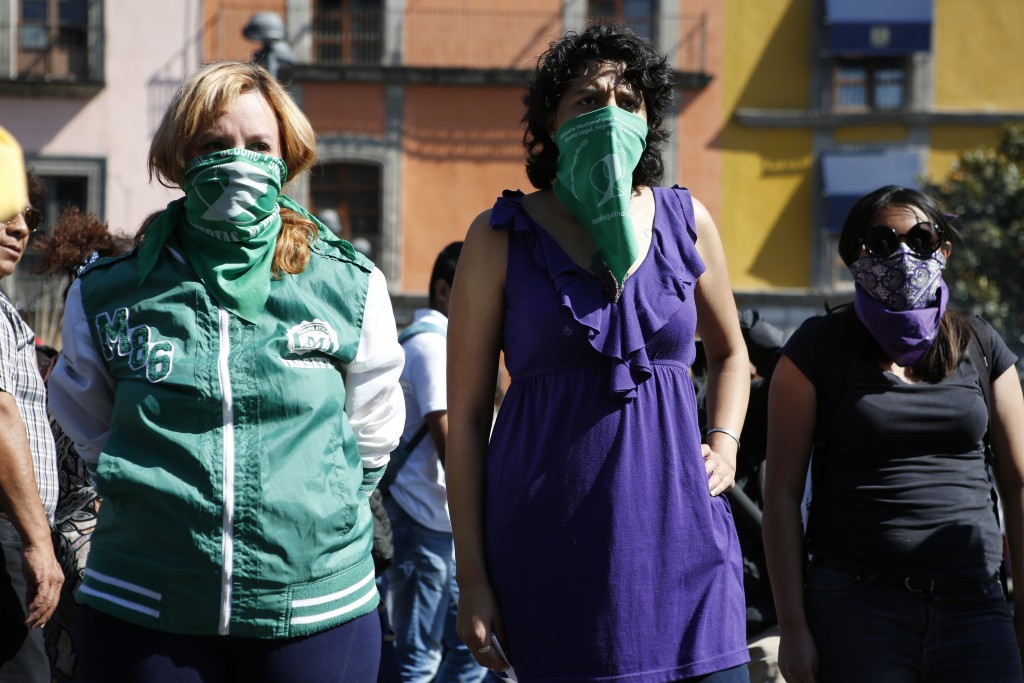 Women participate in a performance in support of abortion rights next to the cathedral in Mexico City, Sunday, Jan. 5, 2020. Mexico's ruling party, Mo...