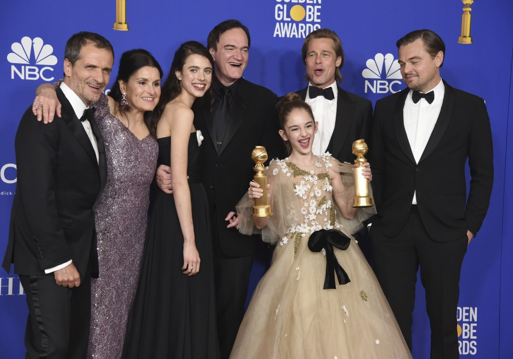 """The cast and crew of """"Once Upon a Time in Hollywood"""" pose in the press room with the awards for best motion picture, musical or comedy and best screen..."""