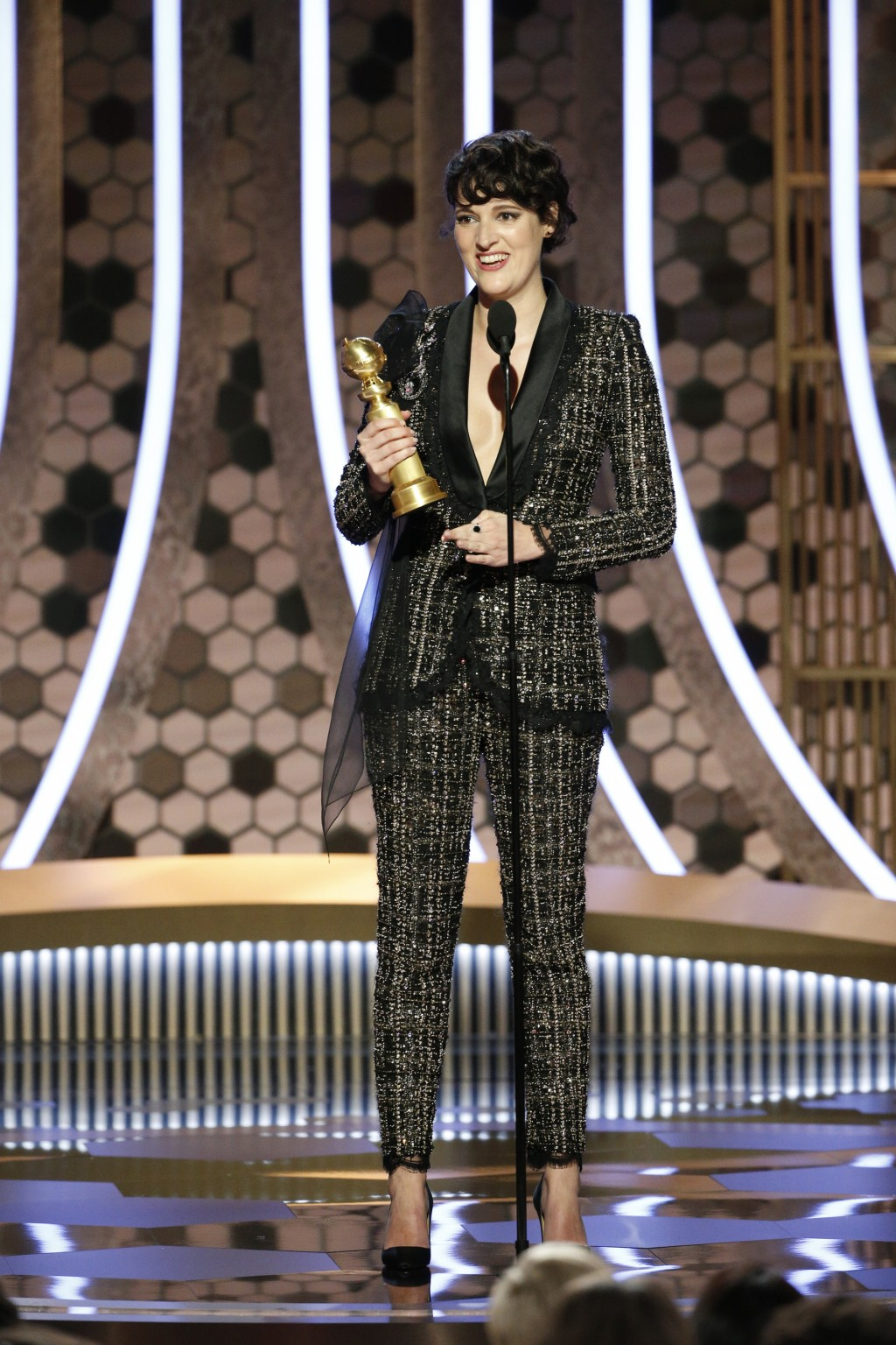 """This image released by NBC shows Phoebe Waller-Bridge accepting the award for best actress in a comedy series for """"Fleabag""""  at the 77th Annual Golden..."""