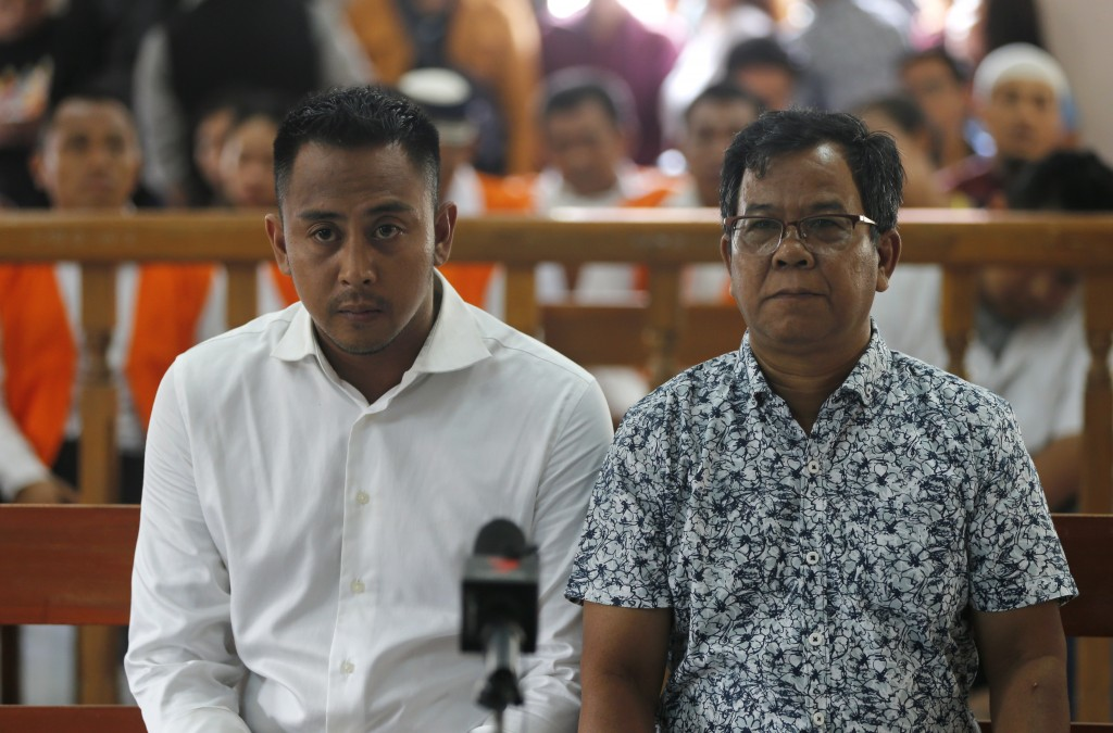 Australian William Cabantog, left, sits in a court room during his verdict trial in Bali, Indonesia on Monday, Jan. 6, 2020. The judge has sentenced C...