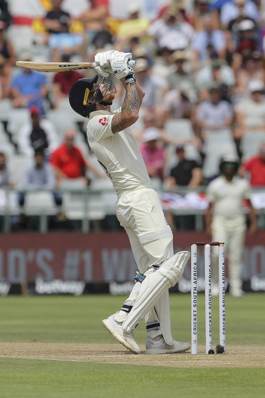 England's batsman Ben Stokes watches as the ball flies high into the outfield, the possible catch was missed by South Africa's wicketkeeper Quinton de...