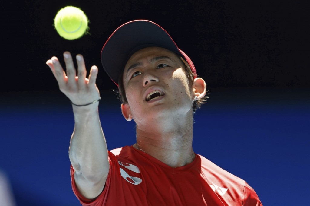 Japan's Yoshihito Nishioka serves to Nikoloz Basilashvili of Georgia during their match at the ATP Cup in Perth, Australia, Monday, Jan. 6, 2020. (AP ...