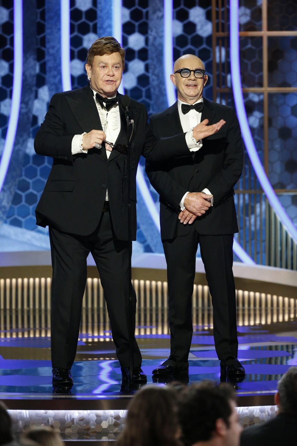 This image released by NBC shows presenters Elton John, left, and Bernie Taupin at the 77th Annual Golden Globe Awards at the Beverly Hilton Hotel in ...