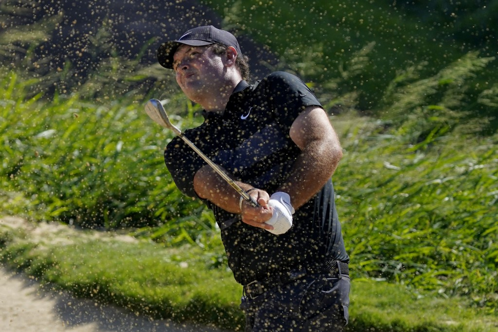 Patrick Reed hits out of the 11th green bunker during final round of the Tournament of Champions golf event, Sunday, Jan. 5, 2020, at Kapalua Plantati...