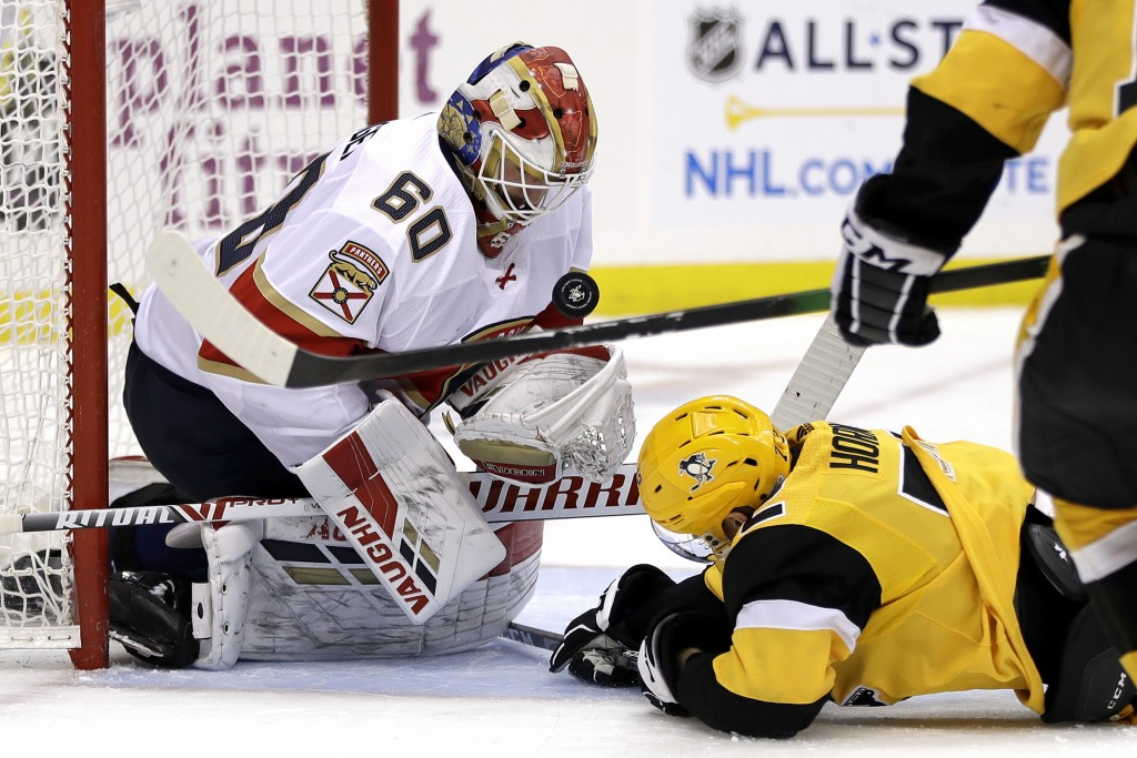 Florida Panthers goaltender Chris Driedger (60) stops a shot by Pittsburgh Penguins' Patric Hornqvist (72) during the second period of an NHL hockey g...