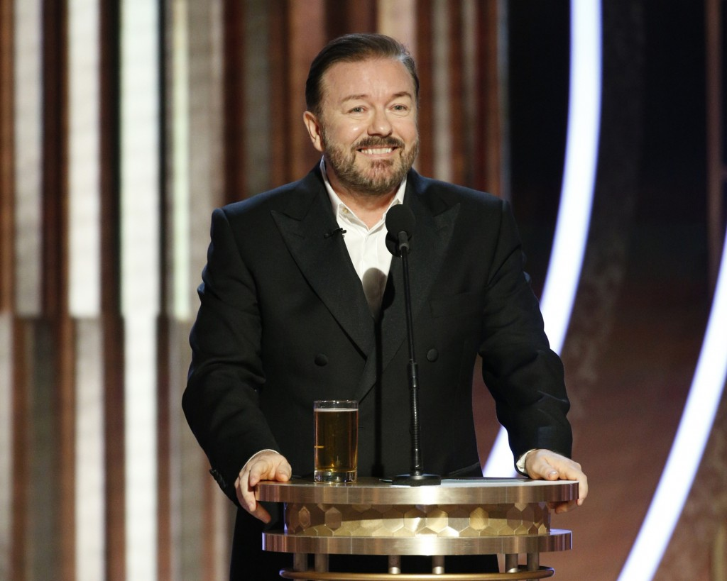 This image released by NBC shows host Ricky Gervais speaking at the 77th Annual Golden Globe Awards at the Beverly Hilton Hotel in Beverly Hills, Cali...