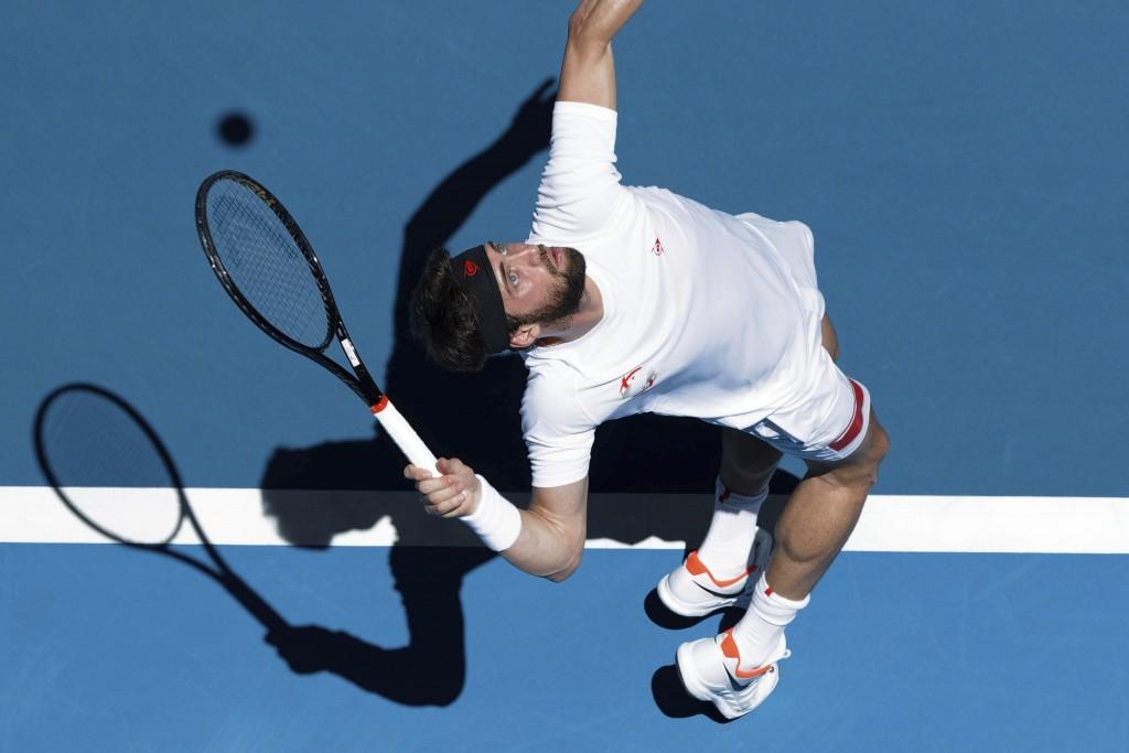 Nikoloz Basilashvili of Georgia serves to Japan's Yoshihito Nishioka during their match at the ATP Cup in Perth, Australia, Monday, Jan. 6, 2020. (AP ...