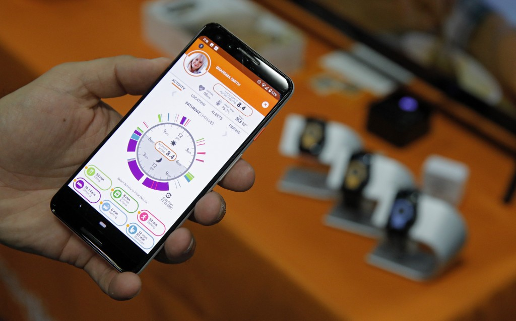 The app for the CarePredict Tempo Series 3 appears on display at the CarePredict booth during CES Unveiled before CES International, Sunday, Jan. 5, 2...
