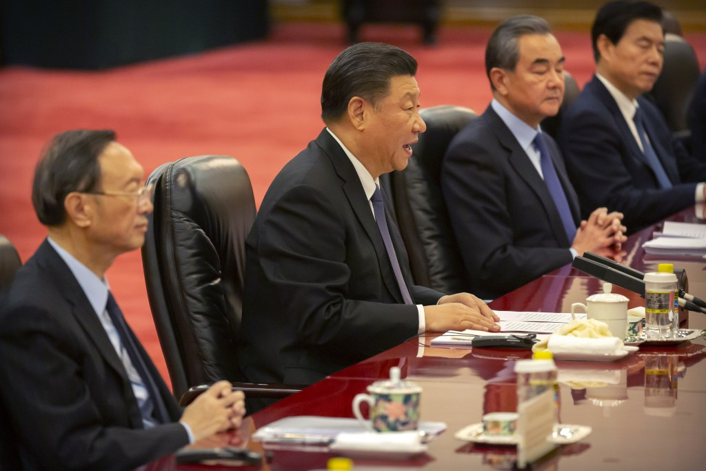 Chinese President Xi Jinping, center, speaks during a meeting with Kiribati's President Taneti Maamau at the Great Hall of the People in Beijing, Mond...