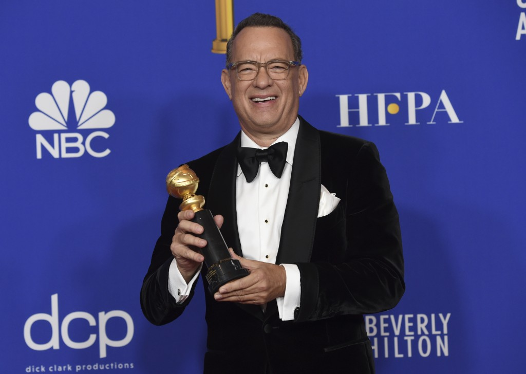 Tom Hanks, winner of the Cecil B. deMille Award, poses in the press room at the 77th annual Golden Globe Awards at the Beverly Hilton Hotel on Sunday,...