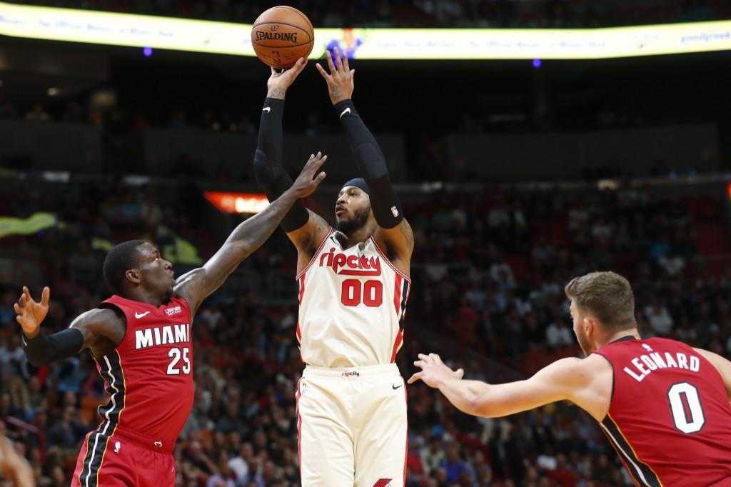 Portland Trail Blazers forward Carmelo Anthony (00) shoots against Miami Heat guard Kendrick Nunn (25) and forward Meyers Leonard (0) during the first...