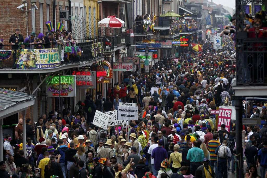 FILE - In this Feb. 12, 2013, file photo, crowds of revelers are seen on Bourbon Street from the balcony of the Royal Sonesta Hotel during Mardi Gras ...