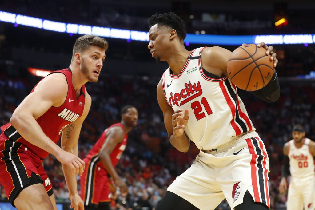 Portland Trail Blazers center Hassan Whiteside (21) drives up against Miami Heat forward Meyers Leonard (0) during the first half of an NBA basketball...