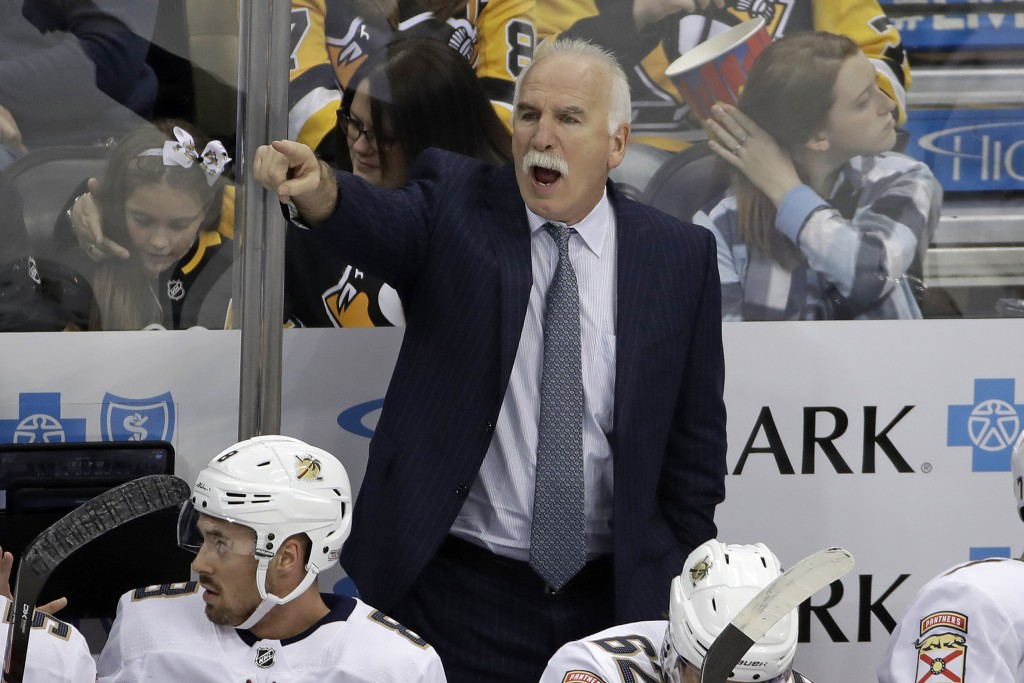 Florida Panthers head coach Joel Quenneville gives instructions during the first period of an NHL hockey game against the Pittsburgh Penguins in Pitts...
