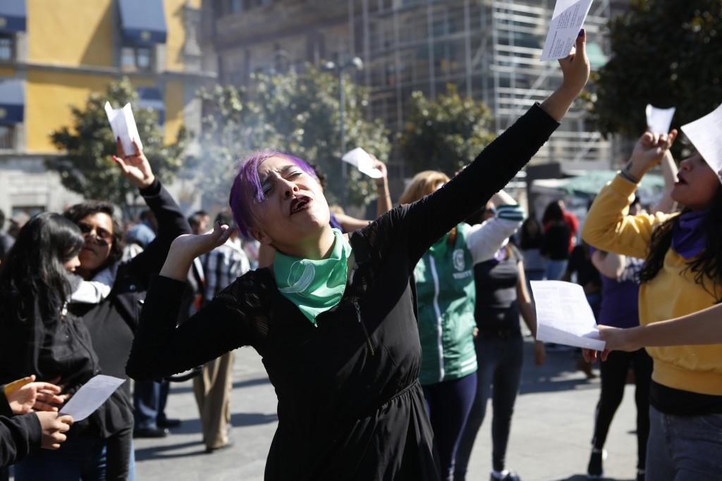 Perla Rosales, 25, participates in a performance in support of abortion rights next to the cathedral in Mexico City, Sunday, Jan. 5, 2020. Mexico's ru...